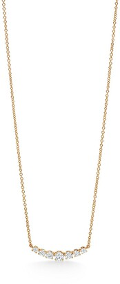 Tiffany & Co. East-west pendant in 18k gold with diamonds