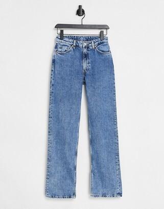 Monki Elsie organic cotton straight leg jeans with split hem in mid blue wash