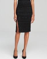 uncategorized  Who made Coco Rochas short sleeve white top and slit print skirt that she wore in New York on September 5, 2014?