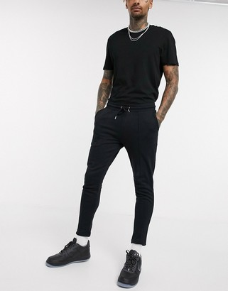 ASOS DESIGN organic pleated jersey joggers in black