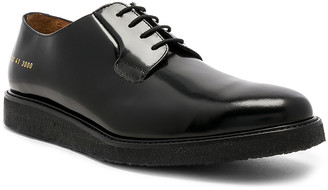 Common Projects Derby Shine in Black & Black | FWRD