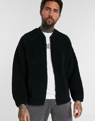 ASOS DESIGN oversized bomber jacket in black teddy borg