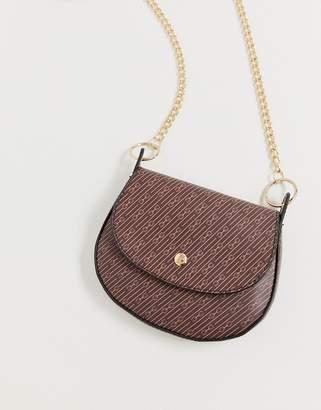 Asos Design DESIGN mini saddle cross body bag in monogram print-Brown