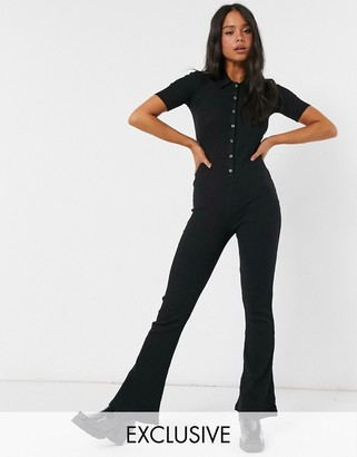 Reclaimed Vintage inspired ribbed flared jumpsuit in black