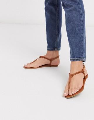 Qupid thong flat sandals in tan