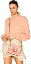 Frame Slouchy Turtleneck Sweater in Neutrals,Pink.