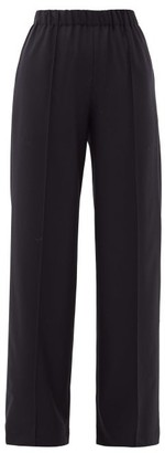Raey Pintucked Elasticated-waist Wool Trousers - Navy