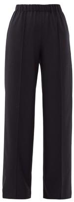 Raey Pintucked Elasticated-waist Wool Trousers - Womens - Navy