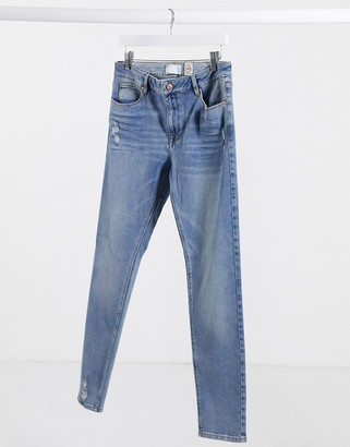 ASOS DESIGN 12.5oz skinny jeans in mid wash blue with abrasions