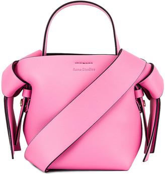 Acne Studios Micro Bucket Bag in Pink & Black | FWRD
