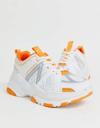 Asos Design DESIGN trainers in white with orange colour pop and chunky sole