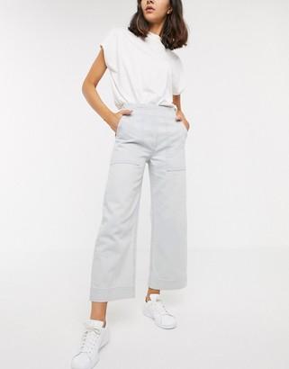 ASOS DESIGN Cropped wide leg carpenter jeans in bleach wash