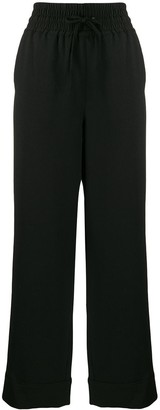 Ganni elasticated wide-leg trousers
