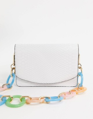 Asos DESIGN shoulder bag with statement chain in white snake
