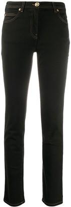 Versace Medusa motif skinny jeans