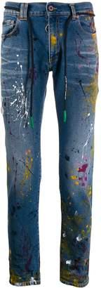 Off-White paint splashed distressed denim jeans