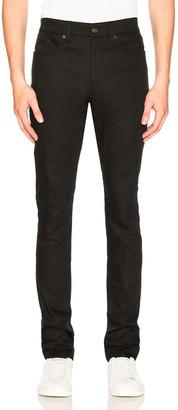 Saint Laurent 5 Pocket Skinny Jeans in Black | FWRD