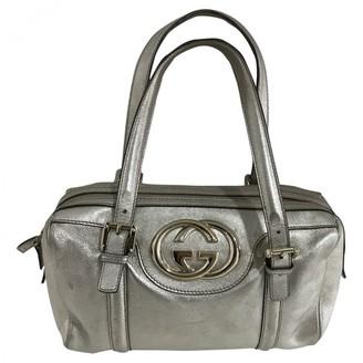 Gucci Metallic Leather Handbags