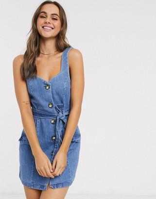 ASOS DESIGN denim button pinafore mini dress in blue