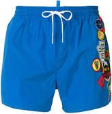 DSQUARED2 badge printed swim shorts