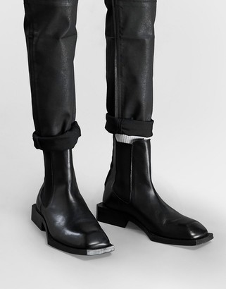 ASOS DESIGN chelsea boots in black leather on angular sole
