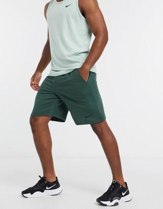 Nike Training fleece shorts in green