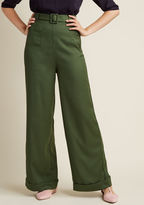 VAW170204C If it's your goal to look glam at all times, then these high-waisted trousers will sure come in handy! Spiffing up your workday with a side-button closure, a single back pocket, a belt, and cuffed wide legs, these olive green pants from Collectif are aspi