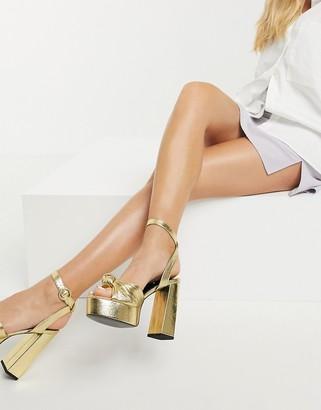 Asos Design ASOS DEISNG Neptune platform high-heeled sandals in gold mirror