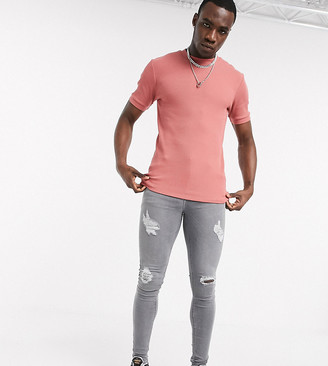 ASOS DESIGN Tall spray on jeans with power stretch with heavy rips in gray