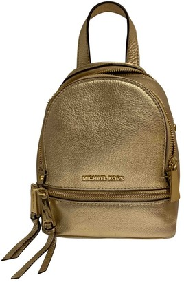 Michael Kors Rhea Gold Leather Backpacks
