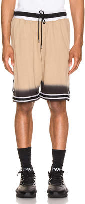 John Elliott Dip Dye Basketball Shorts in Gold & Black | FWRD
