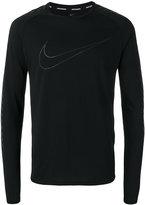 Nike logo top
