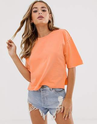 Asos Design DESIGN raw seams t-shirt in washed coral