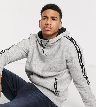 Hollister regular fit hoodie in grey with chest logo and sleeve taping exclusive to ASOS