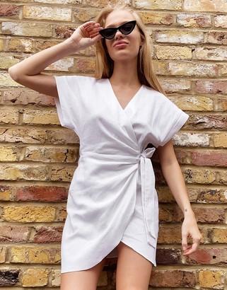 Asos DESIGN linen wrap mini dress in white