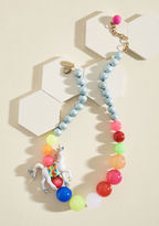 MC-SN29 Now, here's one statement necklace that'll get your creative juices flowing! Featuring colorful beads like blissful bubbles along which a friendship-bracelet-bound unicorn canters, and strings of sparkling silver bits that guide back to its adjustable gol