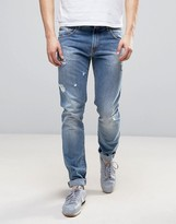 Love Moschino Slim Fit Ripped Jeans In Blue