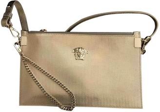 Versace Gold Leather Handbags
