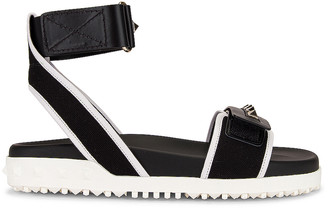 Valentino Rockstud Rubber Sandals in Black & Bianco Ottico | FWRD