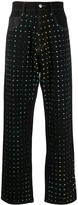 Koché flared jeans with embellishments