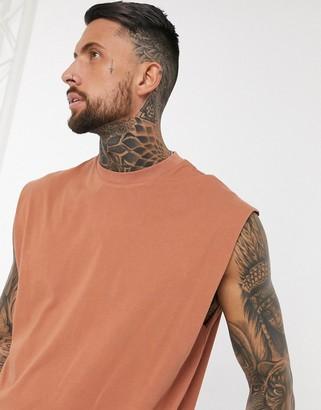 ASOS DESIGN oversized longline sleeveless t-shirt in orange