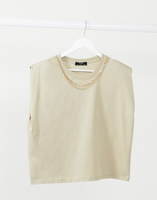 Bershka padded shoulder tee with gold chain detail in mocha