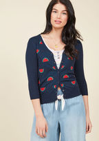 MCS1081 If a healthy dose of fruit in your fashionable ensemble keeps you happy, then this navy blue cardigan from our ModCloth namesake label will have you feeling ecstatic! Complete with a V-neckline, cropped sleeves, and a red, green, and black watermelon wedg