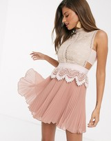 Asos Design DESIGN contrast lace mini dress with peplum and pleated hem in pink