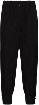 NACKIYÉ Elasticated Waistband Textured Trousers