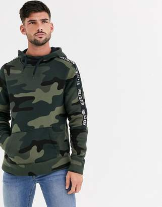 Hollister icon and sleeve tape logo hoodie in olive camo-Green
