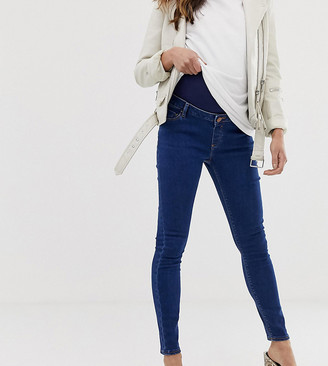 ASOS DESIGN Maternity high rise ridley 'skinny' jeans in rich mid blue wash with over the bump waistband