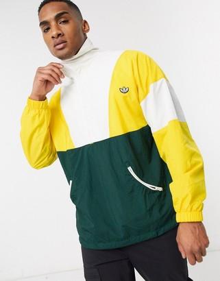 adidas samstag half zip track jacket in yellow
