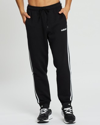 adidas Men's Black Track Pants - Essentials 3-Stripes Tapered Cuffed Pants - Size S at The Iconic