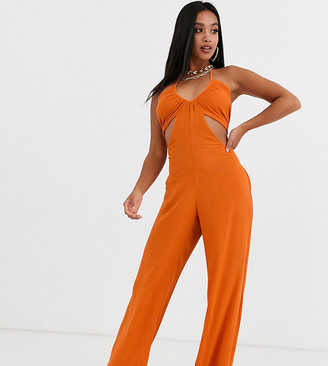 Asos DESIGN Petite crinkle halter wide leg beach jumpsuit with cut outs in ginger